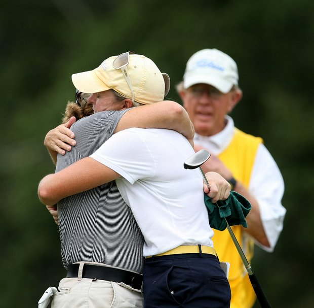 Martha Leach, right, hugs her opponent, Laura Coble after she defeated Coble, 3 and 2.