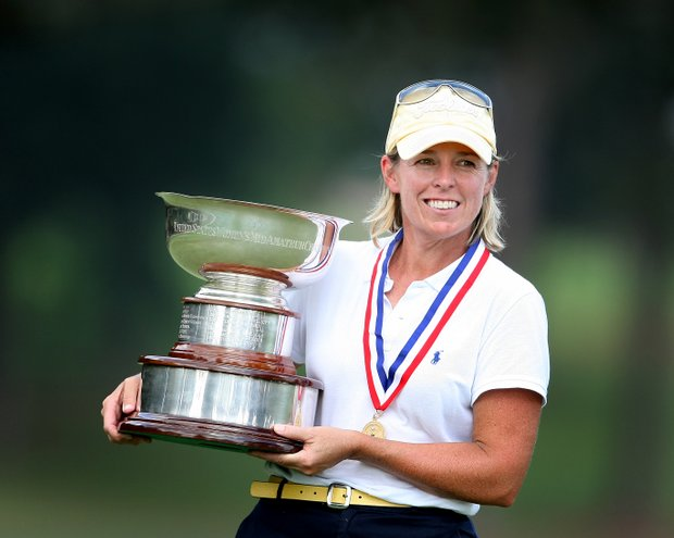 Martha Leach holds the Mildred Gardiner Prunaret Trophy after winning the 23rd U.S. Women's Mid Amateur Championship.