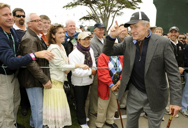 Former President George H.W. Bush tips his cap walking to the first tee box Oct. 8 at Harding Park.