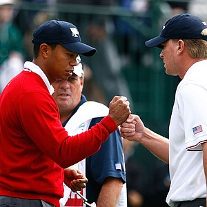 Tiger Woods and Steve Stricker of the U.S. team celebrate on the first hole. They would go on to get a 6-and-4 win over Geoff Ogilvy and Ryo Ishikawa.