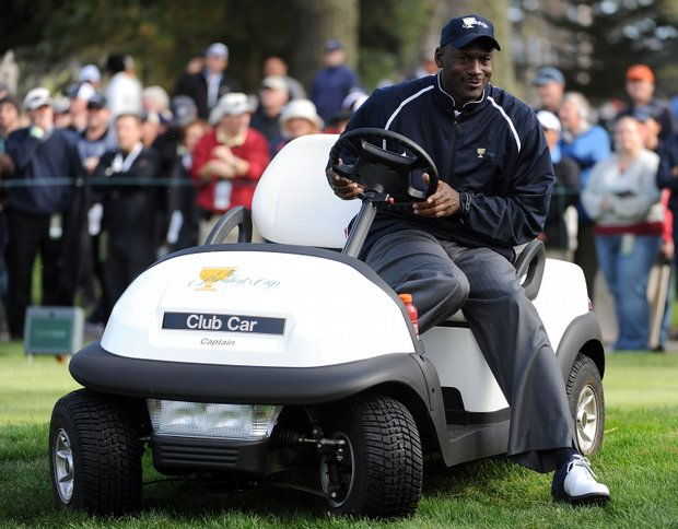 Michael Jordan, an assistant for the U.S. team, waits on a tee box.