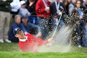 Anthony Kim hits his second shot at the 9th hole. Kim was partnered with Phil Mickelson, and the pair won their match over Mike Weir and Tim Clark of the International team, 3 and 2.