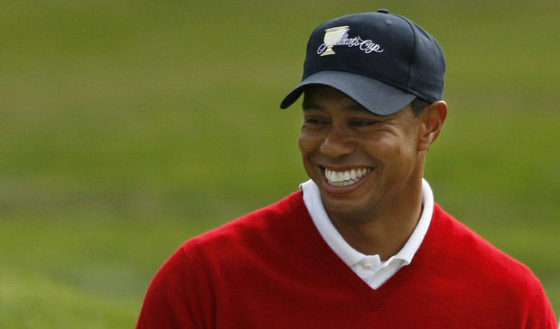 Tiger Woods smiles during Day 1 of the President Cup.