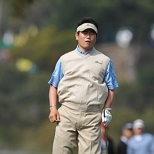 Y.E. Yang of the International Team jumps in the air to watch his chip shot onto the first green. Yang and Ryo Ishikawa beat Kenny Perry and Sean O'Hair, 4 and 3.