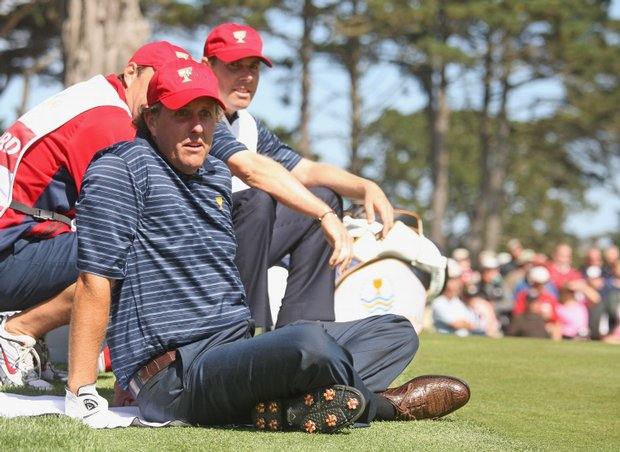 Phil Mickelson and Justin Leonard rest during the Presidents Cup four-ball matches. The pair beat Retief Goosen and Adam Scott, 3 and 2.