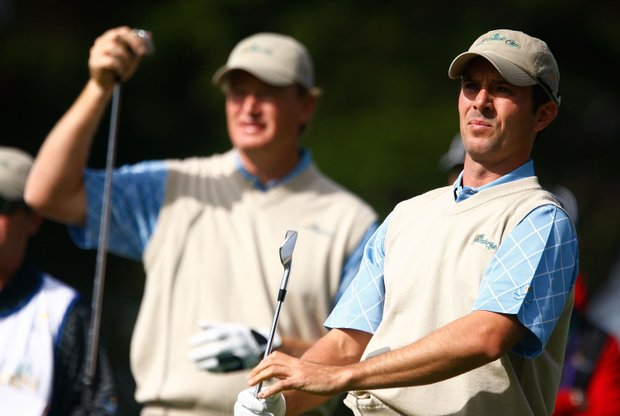 Mike Weir of the International Team watches his tee shot on the second hole as Ernie Els looks. The pair logged a come-from-behind victory against Jim Furyk and Anthony Kim after winning their final three holes.