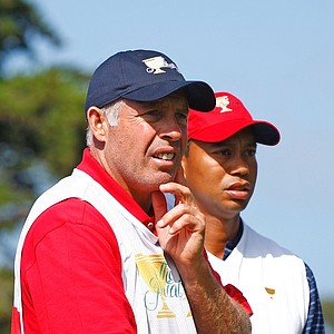 Tiger Woods waits with his caddie Steve Williams on the second tee at the Presidents Cup.