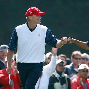 Steve Stricker and Tiger Woods celebrate on the first green during Friday's four-ball matches. Woods and Stricker have played both Presidents Cup matches together so far, and recorded the two largest margins of victory against the Internationals.