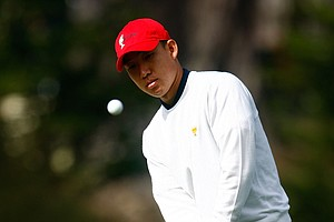 Anthony Kim of the USA Team plays a pitch shot on the first hole.