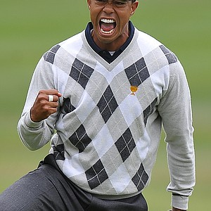 Tiger Woods reacts after making a birdie putt on the 17th hole during Saturday morning foursome matches.