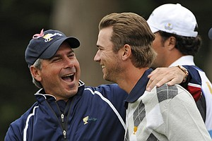 U.S. Team Captain Fred Couples congratulates Sean O'Hair after Mickelson and O'Hair won their match on No. 15 during Saturday's morning foursome matches.