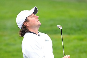 Tim Clark of the International Team reacts to his chip on the 18th hole during the Saturday morning foursome matches.