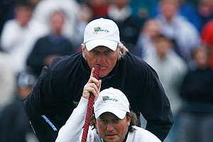 Greg Norman lines up a putt with Tim Clark on the 17th hole during Saturday afternoon fourball matches.