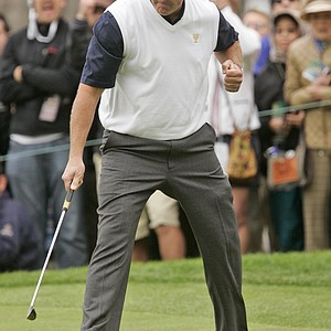 United States player Phil Mickelson reacts to his birdie putt to halve the 14th hole of his foursomes match.