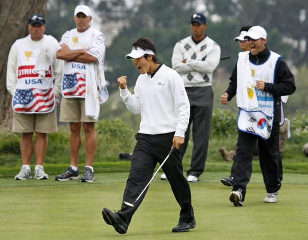 International Team player Ryo Ishikawa celebrates his birdie putt to win the 15th hole of his four-ball match.