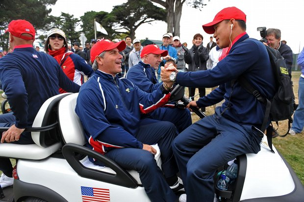 U.S. team captain Fred Couples and Anthony Kim celebrate.