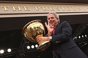 Fred Couples poses with the Presidents Cup.