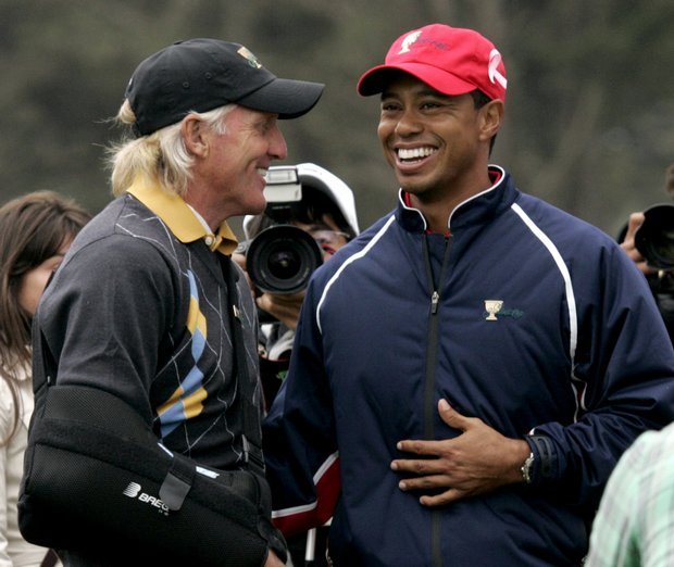 Tiger Woods is congratulated by International captain Greg Norman.