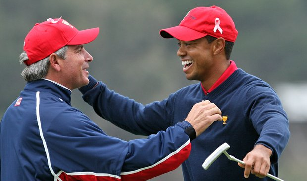 Fred Couples congratulates Tiger Woods after he holed the winning putt for the Americans at the Presidents Cup.