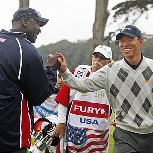 Anthony Kim is cheered on by Michael Jordan during his four-ball match at the Presidents Cup on Oct. 10.
