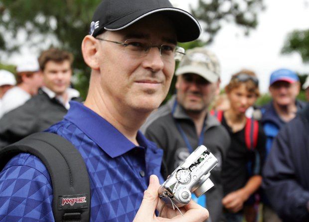 Brad Clegg shows his camera that was thrown against a tree Dec. 11, 2008 by John Daly during the first round of the Australian Open.