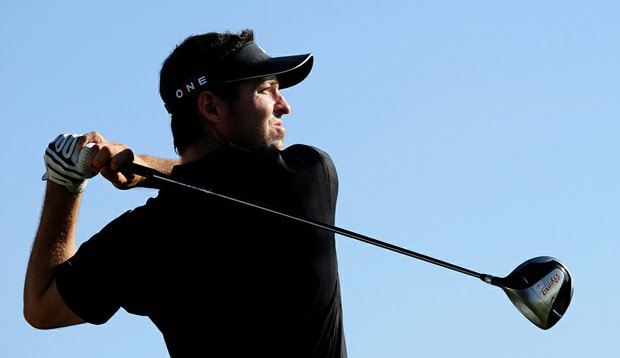 Pablo Martin plays his tee shot on the ninth hole during the Portugal Masters.