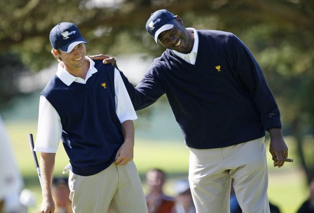 Michael Jordan jokes with Sean O'Hair during a practice round for the Presidents Cup.