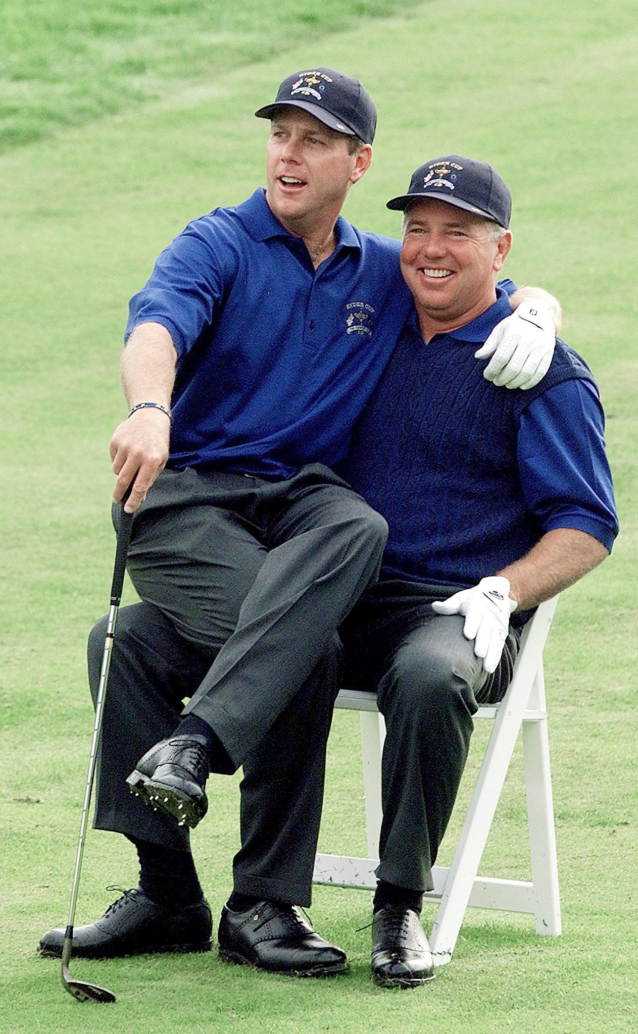Payne Stewart sits on Mark O'Meara's lap September 21, 1999 three days before the start of the Ryder Cup at the Country Club in Brookline, Mass.