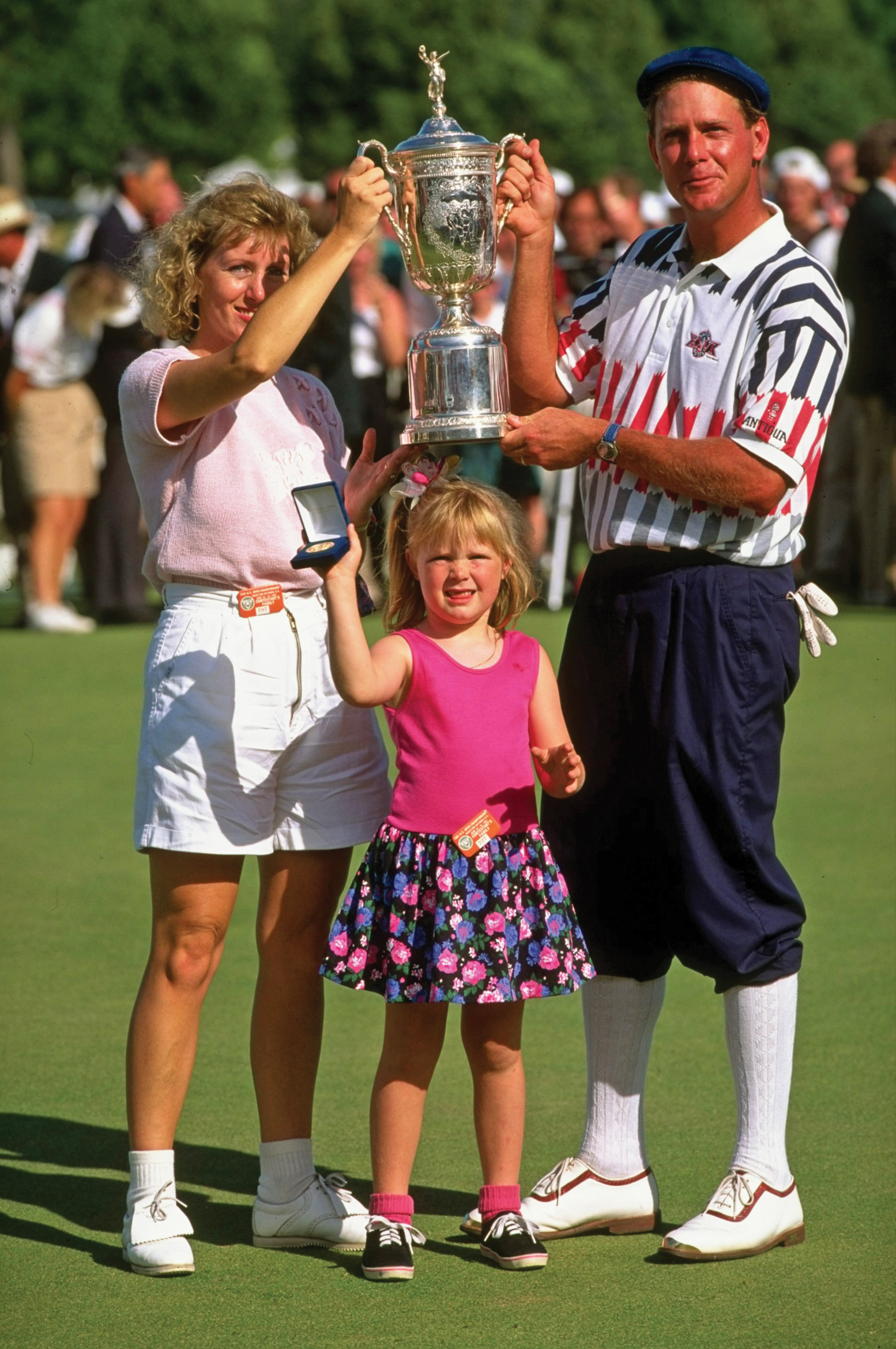 The Stewarts – Tracey, Payne and 5-year-old Chelsea – with the 1991 U.S. Open trophy.