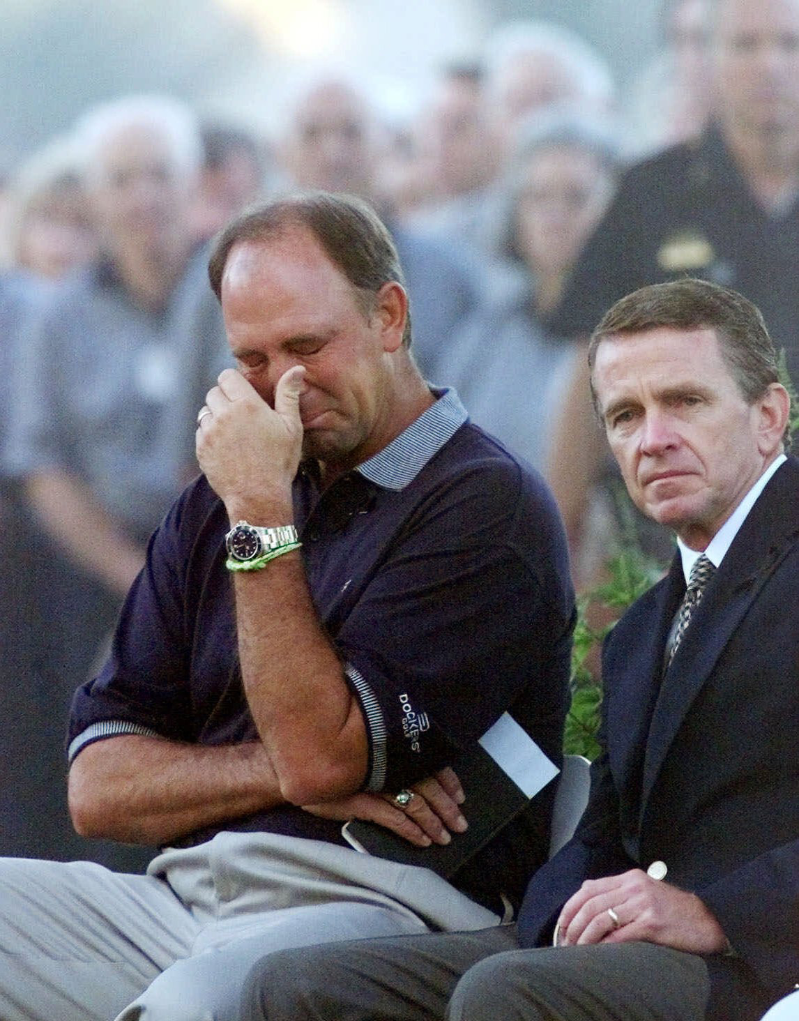 "Tom Lehman, left, wipes his eyes as he listens to a bagpiper play ""Amazing Grace"" while sitting next to PGA Tour commissioner Tim Finchem during a memorial service for Payne Stewart on Oct. 28, 1999 at Champions Golf Club before the start of the Tour Championship."
