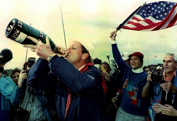 Payne Stewart celebrates with a magnum of champagne after the U.S. defeated Europe in the 1993 Ryder Cup.