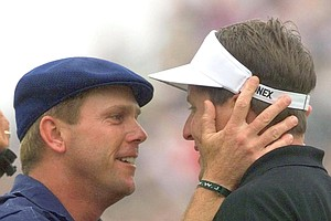 Payne Stewart embraces Phil Mickelson after Stewart sank his winning putt on the 18th green at Pinehurst No. 2 during the final round of the U.S. Open in 1999.