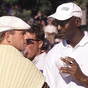 Payne Stewart talks with Michael Jordan at the 1999 Ryder Cup.
