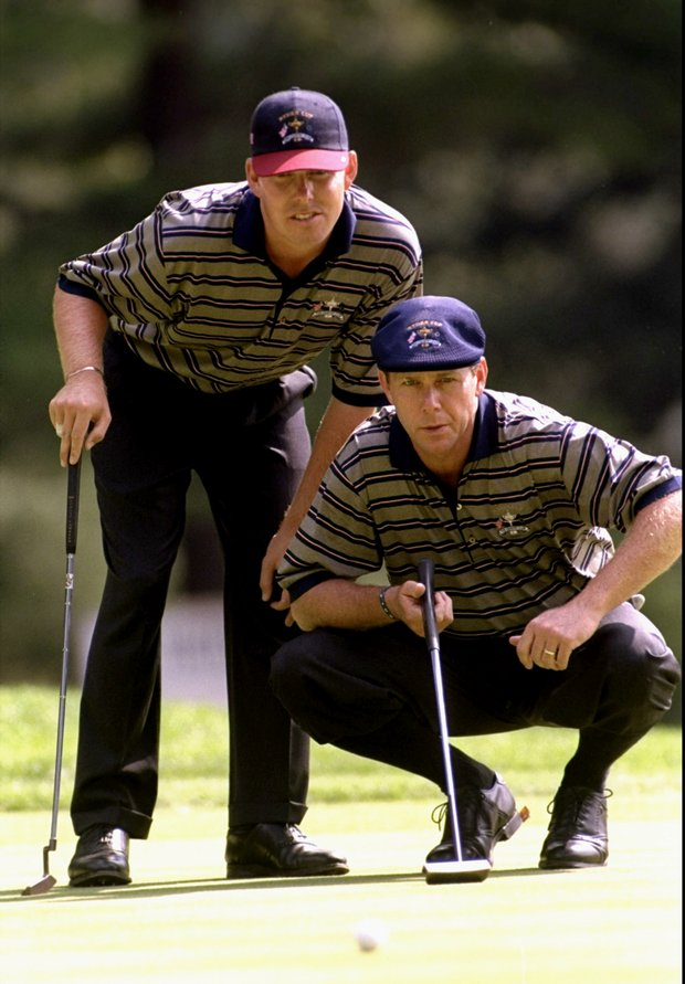 Justin Leonard and Payne Stewart line up a putt during the Ryder Cup at the Brookline in 1999.