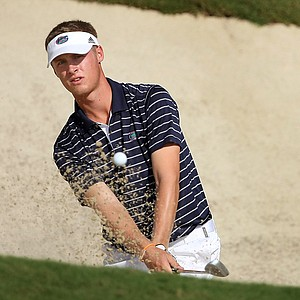 Florida's Tyson Alexander hits out of a bunker at No. 8.