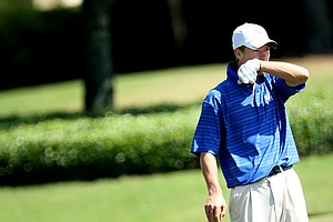 Kentucky's James Kania watches his shot on No. 17 from near the 18th tee.