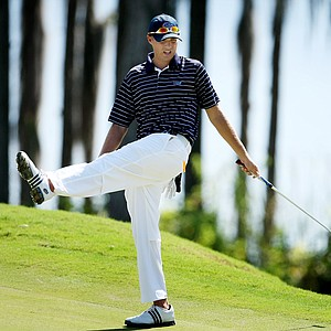 Tim McKenney of University of Florida reacts to his putt at No. 17.