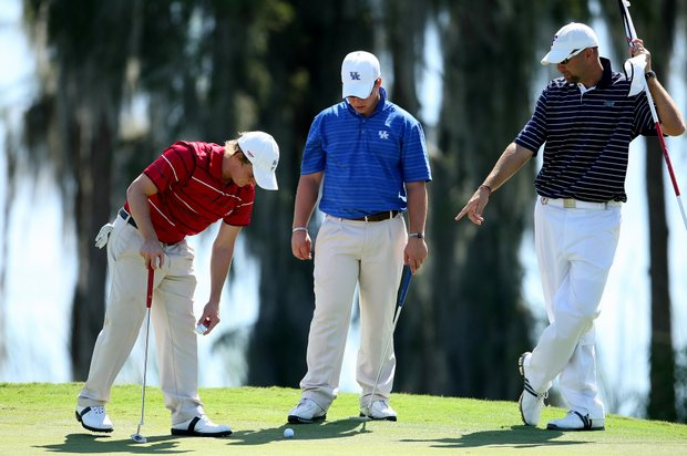 Alabama's Bud Cauley, left, University of Kentucky's Brian Belden, center, and University of Florida assistant coach Steve Bradley, right, at No. 17.