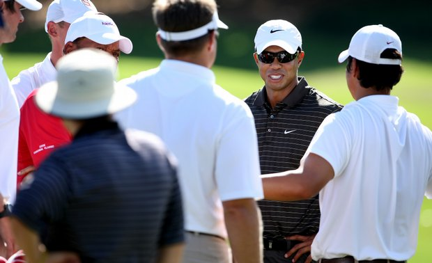 Tiger Woods talks with Stanford players during the Isleworth Collegiate Invitational.