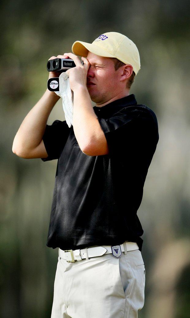 Daniel Jennevret of Texas Christian University checks the yardage at No. 2.