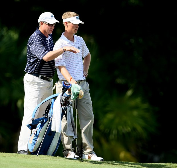 Florida head coach Buddy Alexander talks with his son, Tyson Alexander at No. 5.