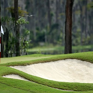 Alabama's Lee Knox hits out of a greenside bunker at No. 18.
