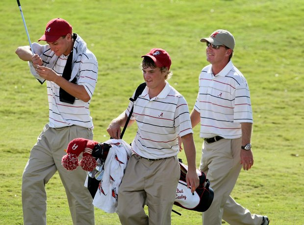 Alabama's Bud Cauley, center, has the individual lead after Round 2.