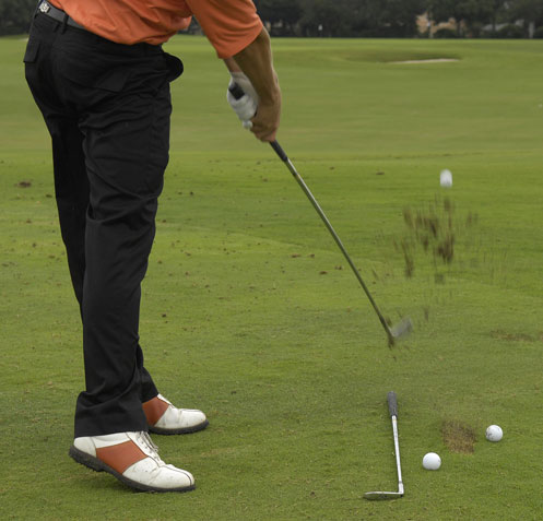 To combat his inside-out move, Fowler will place three balls on the ground: one ball to hit, one inside and behind his target ball and one outside and beyond the target ball. His goal is to contact only the target ball, which prevents him from swinging too far from the inside. If he drops the club too inside on the downswing, he will hit all three balls.