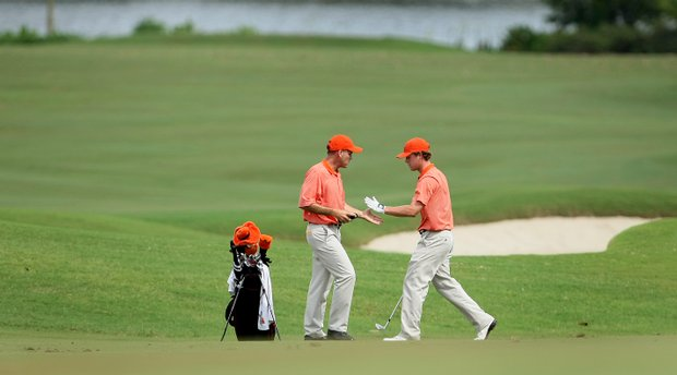 Oklahoma State head coach Mike McGraw with Mark Johnson at No. 13.