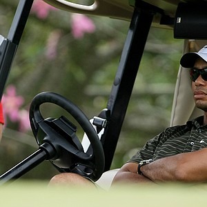 Tiger Woods keeps an eye on Stanford at No. 13.
