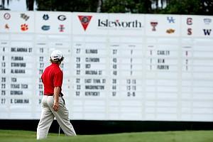 Alabama's Bud Cauley walks past the scoreboard at No. 18.