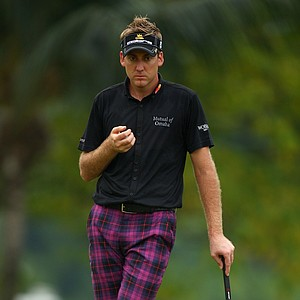 Ian Poulter at the Barclays Singapore Open in black and purple tartans.