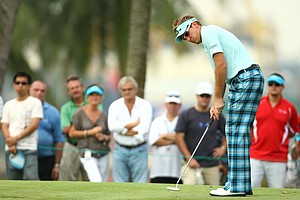 Ian Poulter in IJP signature tartan boot leg trousers in indigo.