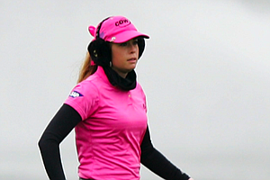 Paula Creamer wears earmuffs to stay warm and still remains trendy.